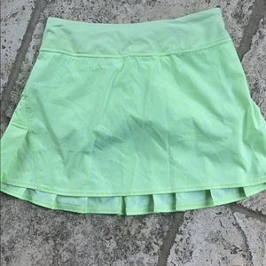 Neon yellow Lululemon Tennis skirt.